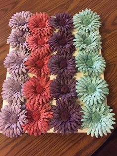 Super cute diy all you need is fake flowers a canvas hot glue and created by spray painting silk flowers desired colors with regular krylon paint then layered with mightylinksfo