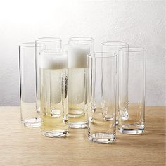 Shop set of 8 cylinder champagne flutes.   Ultra modern clear glass column keeps the bubbly flowing from stemless base to polished fired rim of this champagne flute set.