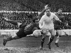 19th November 1966. Chelsea's John Hollins looks in disbelief as Sheffield United Alan Hodgkinson manages to get a hand on the ball at Stamford Bridge