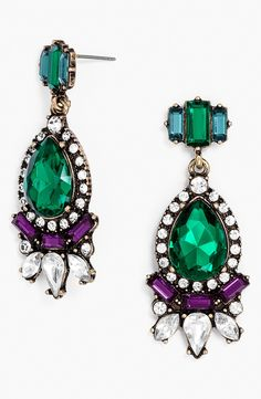 Finishing off a fall outfit with these beautiful emerald and purple drop earrings.