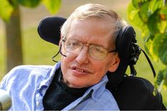 Stephen Hawking wearing glasses and smiling at the camera
