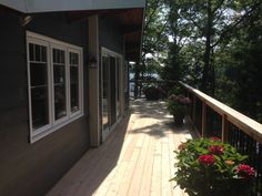 Old Pan-Abode cottage insulated on the exterior, sided with Hardie board siding, and a Cedar Deck with black aluminum spindles overlooking 12-Mile Lake.