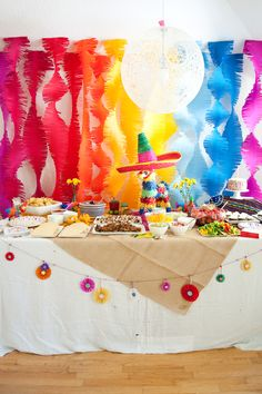 First Birthday Fiesta | Taco bar, piñata, and colorful streamers and garland