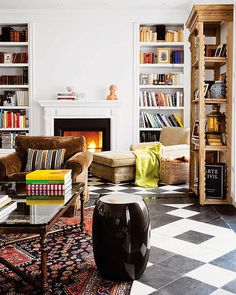 I love the bookcases, rug, flooring, white walls, chaise, coffee table...