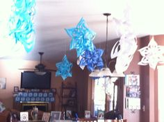 Snowflakes from computer paper for FROZEN party.