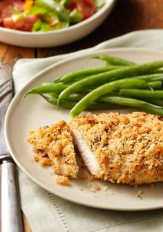 RITZ Parmesan Chicken – A quick dip in a mayo-lemon juice mix and a roll in crushed RITZ Crackers could make this Parmesan chicken breast recipe a new family favorite.