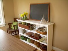 I wish I had a shelf like this in my classroom for storing trays, baskets, vases, etc.