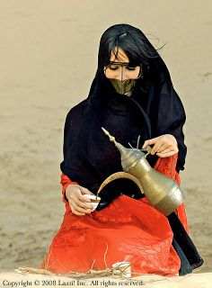 Emirati Woman with face covering Burqa, Sheila and A'baya in the UAE desert.