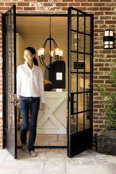 Steel windowed French doors. Love these. I want to do this from my dining room outside..