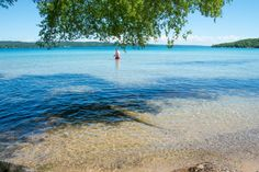 This picturesque lake is known for its pristine, clear water and it is definitely one of the best swimming holes in Michigan. Traverse City Michigan, Torch Lake Michigan, Crystal Lake Michigan, Glen Arbor Michigan, Petoskey Michigan, Vacation Places, Vacation Spots, Places To Travel, Vacation Ideas