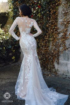 Wedding dress Rosaly by Ange Etoiles. Scoop neckline long sleeves mermaid wedding dress with train and detachable skirt. Ship worldwide. Based in Vancouver, Canada.