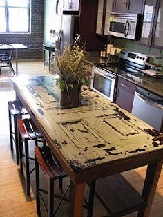 Awesome kitchen island using old door.