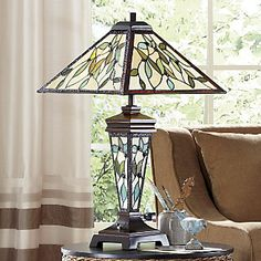 Stained Glass Table Lamp | Handcrafted by skilled artisans in the USA, this exquisite lamp is made with hand cut pieces of stained glass, each wrapped in fine copper foil.