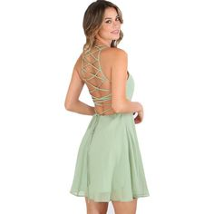 Get ready for a party in this fab green dress! This dress features a criss cross lace up back. Material: Polyester