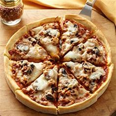 Nothing's better than a homemade crust for a deep dish pizza with Italian sausage, mushrooms, and lots of cheese.