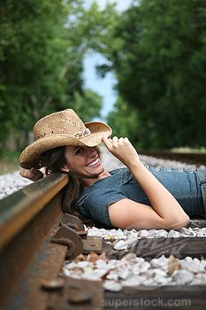 women railroad tracks photography | Woman lying on railroad tracks | Stock Photo #1826R-2458