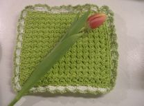 This crunch stitch potholder from Lisa Gonzalez is perfect for spring. Featuring a luxurious bumpy texture, this easy crochet potholder pattern works up quick and gives a healthy dose of color to your kitchen.