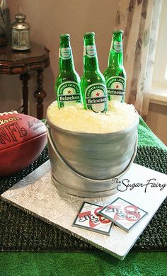 Bucket o' Beer Cake!  The bottles are made from sugar and the tops are chocolate.  The whole thing is edible, including the printed labels and coasters!