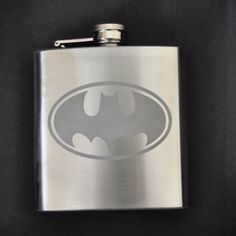 Holy Flask Batman! This is a Hip and Awesome stainless steel flask with a 6 ounce liquid capacity.    The flask also has a screw down hinged top with