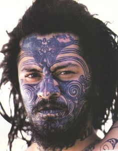 face tattoo, south pacific islander, maori, photo, portrait, blue ink, wild, primal, tribal
