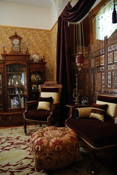 Victorian Inspired Living Room. I like the global touches here. Like found treasures from great adventures. I'll bet the owner wears a pith helmet.