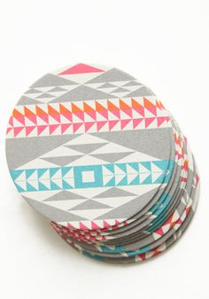 Tribal Colors Coasters from Threadsence. too bad they are not made of more durable material, but they are super adorable!