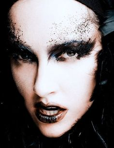 Avant-Garde Gothic Makeup. Black eye shadow and glitter, great for a classy halloween makeup look