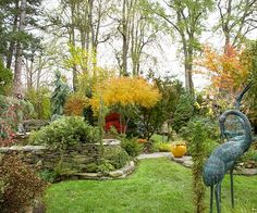 We'll start our garden tours with a Northeastern garden that's full of color and texture. It may look huge, but it's actually just an average-size city lot. Read on to learn how you can transform any small space into a private retreat filled with fall color./