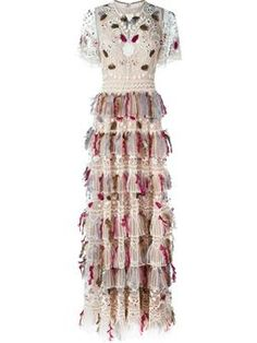 Trying to figure out what makes this a $42,000 dress.  Are the feathers from dodos?