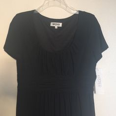 Kasper Pleated Dress Simple yet elegant black dress. Can easily transition from work to date night dress with some great accessories. Never worn. 95% polyester 5% spandex. Side zip. Dry clean. Kasper Dresses