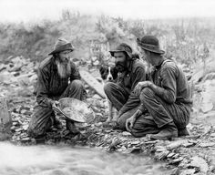 Three grizzled prospectors and their dog pan for gold in Rockerville, South Dakota, near Rapid City around the year Based upon a photograph taken by John C. Gold C, Gold Rush, Antique Photos, Vintage Photos, Panning For Gold, Gold Miners, Photo Gold, Old West, Historical Photos
