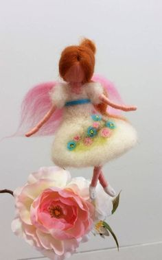 This is one miniature figurine- delicate sweet doll with pale brown hair and beautiful white dress with three small flowers on it. I made it of needle felted wool with lot of love and attention. This doll is perfect decoration for the childrens room or in nursing. Great gift for