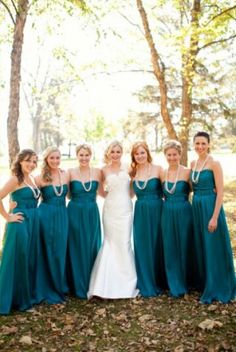 Teal bridesmaids dresses. pretty but needs to be lighter