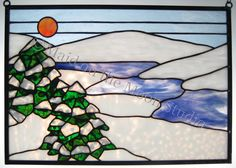Whether adapted from photographs or drawn directly from the flowers and trees that grow in our garden, these stained glass designs are true to life ...
