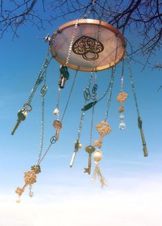 Steampunk Wind Chime-wind chime in offbeat fashion, it a little bit of everything!  This little wind chime is basically a mix of  embroidery supplies, vintage bits and bobs, lace, and gears and skeleton keys. I can't wait to make one.