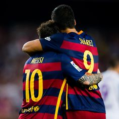 Lionel Messi and Luis Suarez of FC Barcelona celebrate after their teammate Thomas Vermaelen scored the opening goal during the La Liga match between FC Barcelona and Malaga CF at Camp Nou on August 29, 2015 in Barcelona, Catalonia.