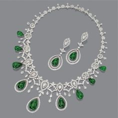 DIAMOND AND EMERALD NECKLACE AND EARRINGS. The graduated necklace of lace design set with 18 rose-cut diamonds and numerous round diamonds supporting a fringe of 9 emerald drops, the matching pendant earclips set with 2 rose-cut and numerous round diamond Emerald Necklace, Emerald Jewelry, Diamond Jewelry, Gold Necklace, Emerald Rings, Moonstone Jewelry, Jewelry Sets, Fine Jewelry, Graduation Necklace