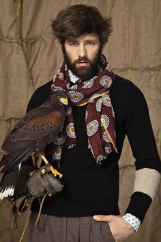 Put a bird on that hipster. The falcon & the snowman hipster. osama ben affleck beard with required scarf.