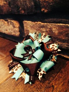 FABULOUS bow ! on Etsy, $8.25. Turquoise and brown with some leopard and rhinestones. OTT bow.