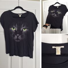 Forever 21 Graphic Tee Shirt Size M. Only worn a few times. It's a dark grey/black shirt. 100% Cotton. Soft material. Feel free to make an offer. Bought it because I had a cat faze, but didn't end up wearing it much.  Forever 21 Tops Tees - Short Sleeve