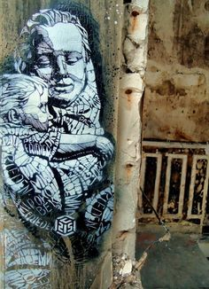 Peace  by  C215 (French street artist, aka Christian Guémy) :: mother and child piece at Vitry-sur-Seine, a suburb of Paris, France