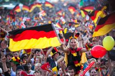 German soccer fans celebrate the kick off of their team's first game at the Euro 2012 at a public viewing zone called 'fan mile' in Berlin, Germany, on June 9. Germany plays against Portugal in Lviv, Ukraine during the Euro 2012 soccer championship. (Markus Schreiber/Associated Press) #