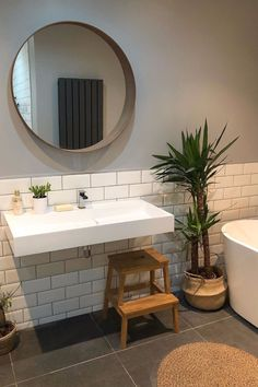 With so many mirror options you don't have to opt for the standard frameless square mirror most commonly scene. This circular mirror keeps the space fun and interesting. The galvanized metal look always work with subway tiles and jute.