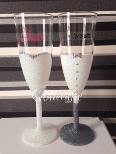 Bride and groom glitter flutes in white and grey https://m.facebook.com/Glitterifficglassesandmore