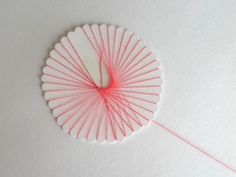 This is an easy, cheap and great way to do some string art with a bunch of girls. :) Spirelli String Art