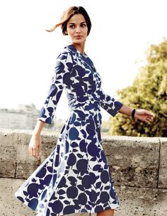 Stylist: Like the length, waist fit, and color combo of this wrap dress.