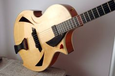 Staf Geers  http://www.vintageandrare.com/category/Guitars-51