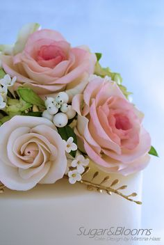 Sugar flower cake in pastell shades - roses, sweet peas, hydrangeas and berries out of gumpaste, sugarpaste