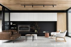 Dark wall in the backdrop adds to the sophisticated appeal of the interior