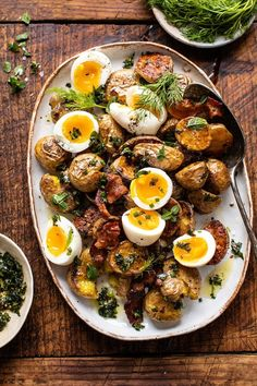 Crispy Breakfast Potatoes with Chili Garlic Oil and Herbs…this is that can't beat brunch dish that everyone loves. Roasted baby potatoes, crispy bacon, and soft-boiled eggs, all served together and topped with a garlic chili oil and plenty of fresh herbs. Brunch Dishes, Brunch Recipes, Breakfast Recipes, Brunch Ideas, Breakfast Platter, Bacon Breakfast, Breakfast And Brunch, Breakfast Salad, Brunch Menu